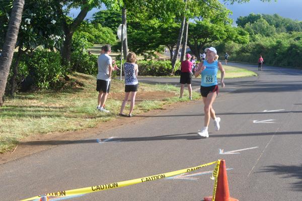 Linda Sherman sprinting for the 5K finish