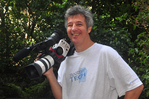 Ray Gordon professional videographer holding video camera