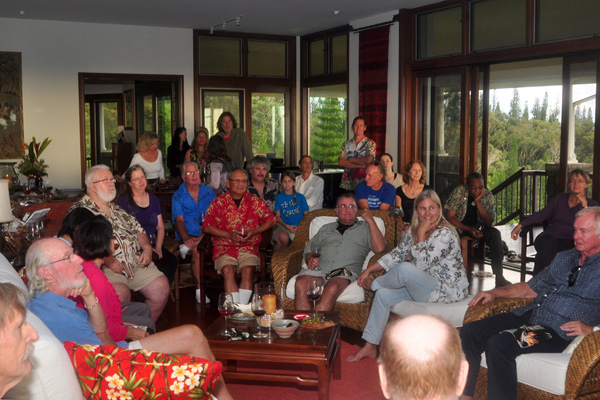 Guests enjoying Michael Cuervorst reading his poetry at his birthday party