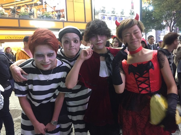 four boys two in drag on Halloween in Shibuya Tokyo Japan